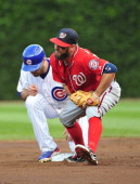 Kevin Frandsen of the Washington Nationals forces out Nate Schierholtz of the Chicago Cubs in the second inning during the second game of a...