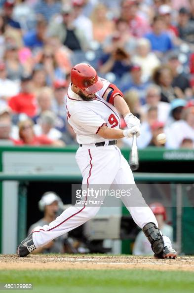 Kevin Frandsen of the Washington Nationals hits a single in the eighth inning against the Philadelphia Phillies at Nationals Park on June 5 2014 in...