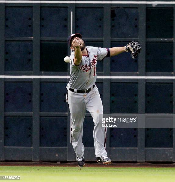 Kevin Frandsen of the Washington Nationals plays a ball off the wall hit by Matt Dominguez of the Houston Astros in the third inning at Minute Maid...