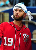 Kevin Frandsen of the Washington Nationals relaxes in the dugout during the rain delay before the game against the Atlanta Braves at Turner Field on...