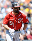 Kevin Frandsen of the Washington Nationals runs to first base during the game against the Pittsburgh Pirates on May 25 2014 at PNC Park in Pittsburgh...