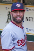 Kevin Frandsen of the Washington Nationals stands in the dugout before the game against the Oakland Athletics at Oco Coliseum on May 9 2014 in...