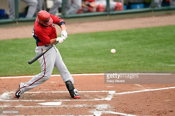 Kevin Frandsen of the Washington Nationals swings at a pitch during the third inning of a spring training game against the Atlanta Braves at Champion...