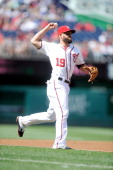 Kevin Frandsen of the Washington Nationals throws the ball to first base against the Philadelphia Phillies at Nationals Park on June 5 2014 in...