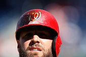 Kevin Frandsen of the Washington Nationals wears a helmet smudged with pine tag as he bats in the seventh inning of a 32 win over the Philadelphia...