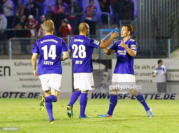 Kevin Freiberger of Lotte celebrates the fourth goal with team mates during the Regionalliga West match between Sportfreunde Lotte and Rot Weiss...