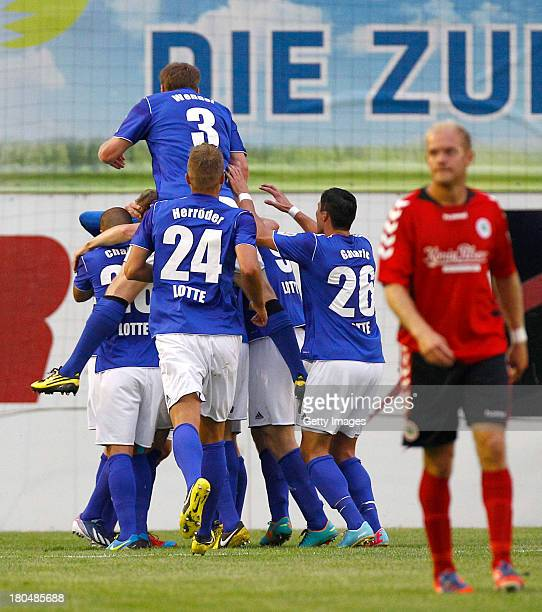 Kevin Freiberger of Lotte celebrates the opening goal with team mates during the Regionalliga West match between Sportfreunde Lotte and Rot Weiss...