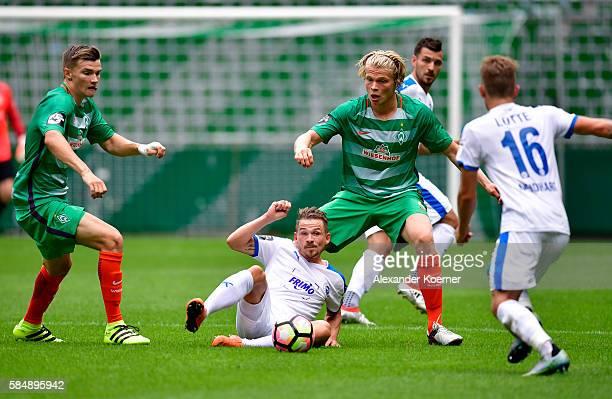 Kevin Freiberger of Sportfreunde Lotte and Jesper Verlaat of Werder Bremen II compete for the ball during Werder Bremen II vs Sportfreunde Lotte 3...