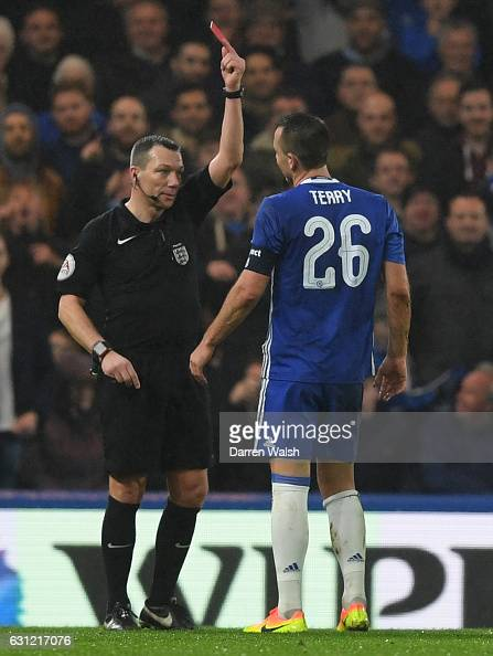 Kevin Friend shows John Terry of Chelsea a red card during The Emirates FA Cup Third Round match between Chelsea and Peterborough United at Stamford...