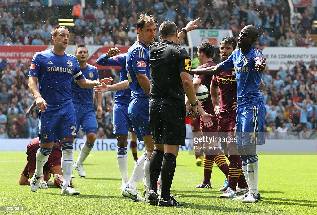 Kevin Friend, the referee sends off <a gi-track='captionPersonalityLinkClicked' href=/galleries/search?phrase=Branislav+Ivanovic&family=editorial&specificpeople=607152 ng-click='$event.stopPropagation()'>Branislav Ivanovic</a> of Chelsea after a tackle on Aleksander Kolarov during the FA Community Shield match between Manchester City and Chelsea at Villa Park on August 12, 2012 in Birmingham, England.