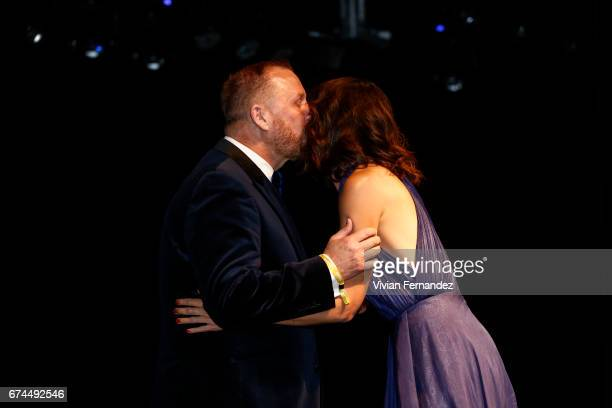 Kevin Frost and Katie Holmes onstage during the 7th Annual amfAR Inspiration Gala on April 27 2017 in Sao Paulo Brazil