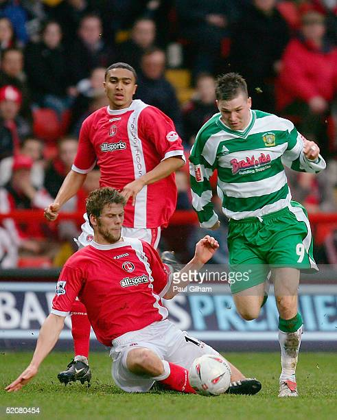 Kevin Gall of Yeovil Town battles for the ball with Hermann Hreidarsson of Charlton Athletic during the FA Cup fourth round match between Charlton...
