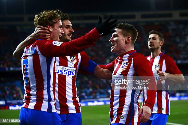 Kevin Gameiro celebrates scoring their third goal with teammates Antoine Griezmann and Koke during the Copa del Rey quarterfinal match between Club...