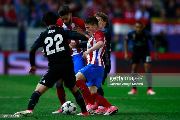 Kevin Gameiro of Atletico de Madrid and his teammate Yannick Carrasco competes for the ball with Francisco Roman Alarcon alias Isco and Luka Modric...