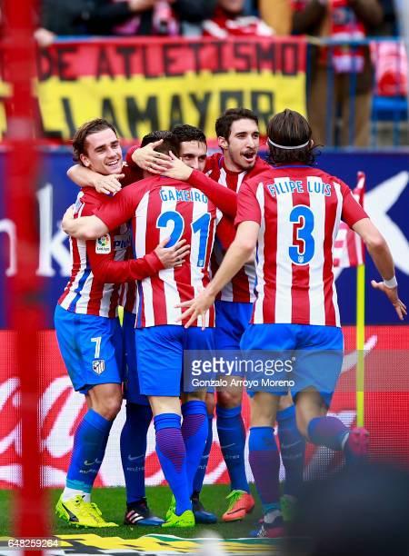Kevin Gameiro of Atletico de Madrid celebrates scoring their second goal with teammates Antoine Griezmann Koke Sime Vrsaljko and Filipe Luis during...