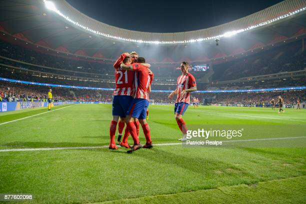 Kevin Gameiro of Atletico de Madrid celebrates with teammates after scoring the second goal of his team during a match between Atletico Madrid and AS...