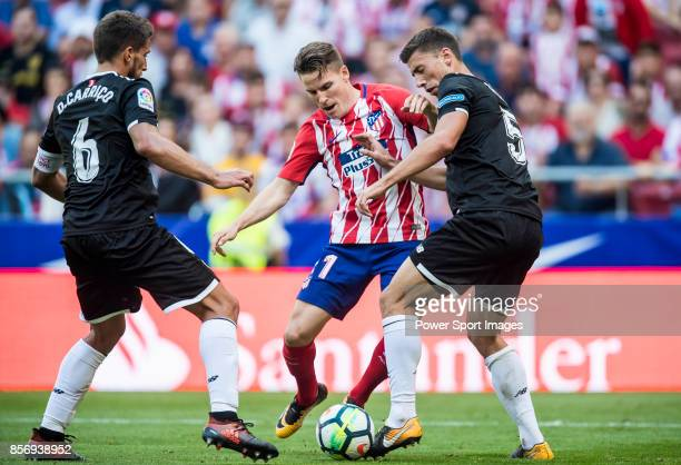 Kevin Gameiro of Atletico de Madrid fights for the ball with Clement Nicolas Laurent Lenglet of Sevilla FC during the La Liga 201718 match between...