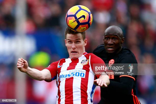 Kevin Gameiro of Atletico de Madrid wins the header after Eliaquim Mangala of Valencia CF during the La Liga match between Club Atletico de Madrid...