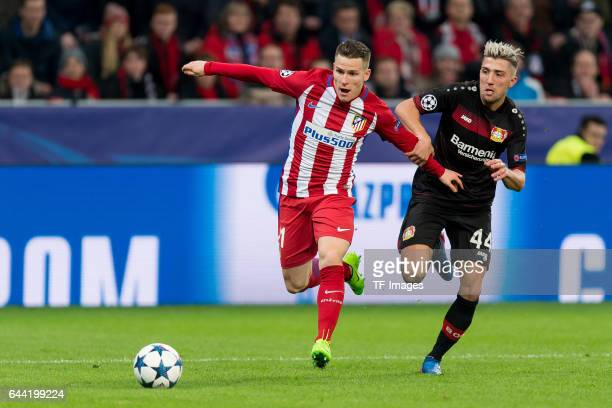 Kevin Gameiro of Atletico Madrid and Kevin Kampl of Bayer Leverkusen battle for the ball during the UEFA Champions League Round of 16 first leg match...