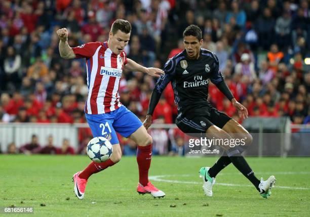 Kevin Gameiro of Atletico Madrid and Raphael Varane of Real Madrid during the UEFA Champions League Semi Final second leg match between Club Atletico...