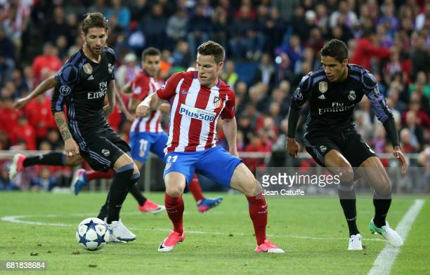 Kevin Gameiro of Atletico Madrid between Sergio Ramos and Raphael Varane of Real Madrid during the UEFA Champions League Semi Final second leg match...