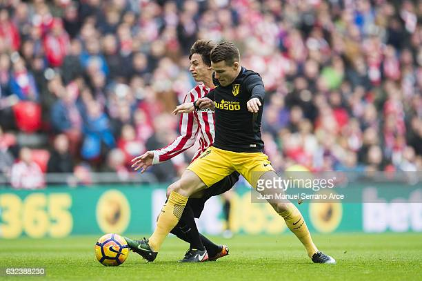 Kevin Gameiro of Atletico Madrid competes for the ball with Ander Iturraspe of Athletic Club during the La Liga match between Athletic Club Bilbao...