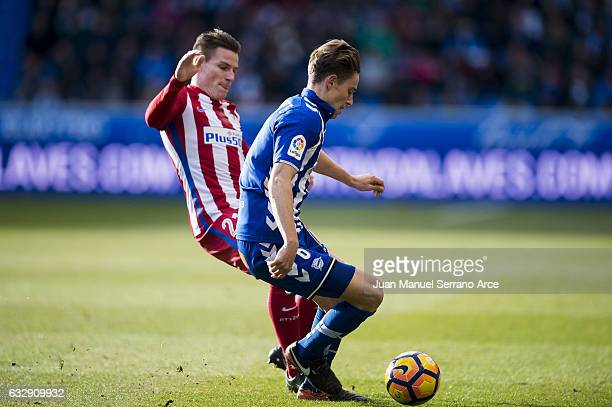 Kevin Gameiro of Atletico Madrid duels for the ball with Marcos Llorente of Deportivo Alaves during the La Liga match between Deportivo Alaves and...