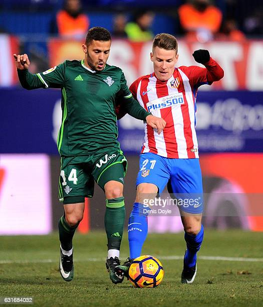 Kevin Gameiro of Club Atletico de Madrid battles for the ball against Riza Durmisi of Real Betis Balompie during the La Liga match between Club...