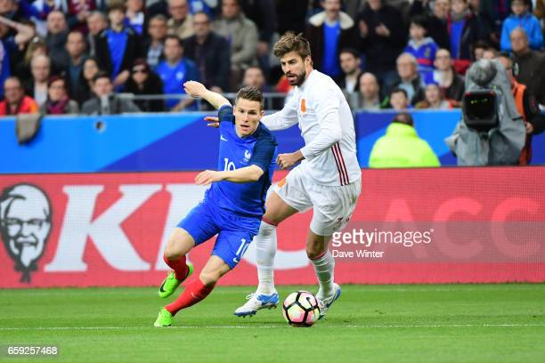Kevin Gameiro of France and Gerard Pique of Spain during the friendly match between France and Spain at Stade de France on March 28 2017 in Paris...