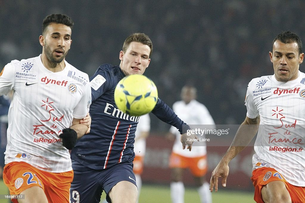 Kevin Gameiro (C) of Paris Saint-Germain and Hilton R) and Abdelhamid El Kaoutari of Montpellier Herault SC during the French League 1 between Paris Saint-Germain FC and Montpellier Herault SC, at Parc des Princes on March 29, 2013 in Paris, France.