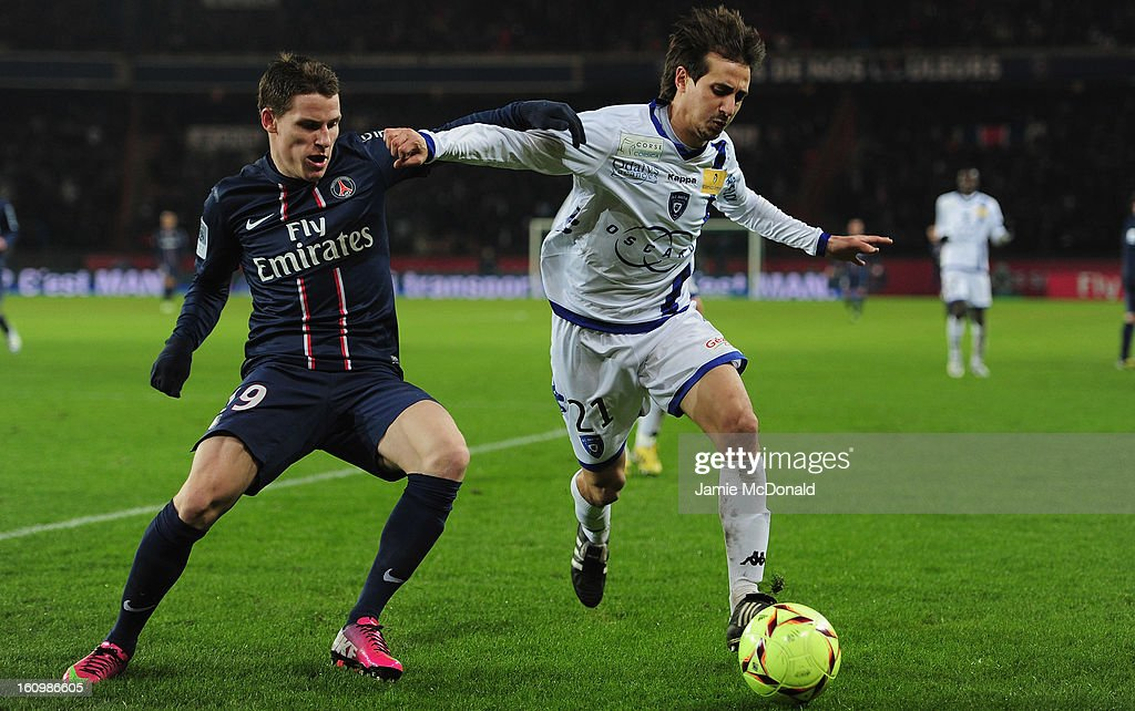 Kevin Gameiro of Paris Saint-Germain battles with Fethi Harek of SC Bastia during the Ligue 1 match between Paris Saint-Germain FC and SC Bastia at Parc des Princes on February 8, 2013 in Paris, France.