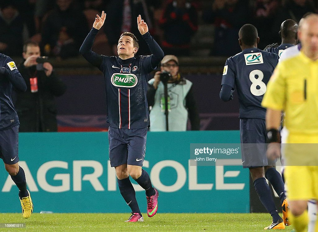 Kevin Gameiro of PSG celebrates his goal by paying homage to Nick Broad, member of the PSG staff who died a week ago in a car accident, during the French Cup match between Paris Saint Germain FC and Toulouse FC at the Parc des Princes stadium on January 23, 2013 in Paris, France.
