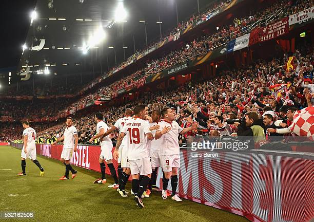 Kevin Gameiro of Sevilla celebrates scoring his team's first goal in front of his team's supporters during the UEFA Europa League Final match between...