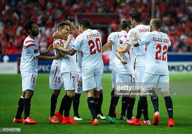 Kevin Gameiro of Sevilla celebrates scoring his team's third goal with team mates during the UEFA Europa League Semi Final first leg match between FC...