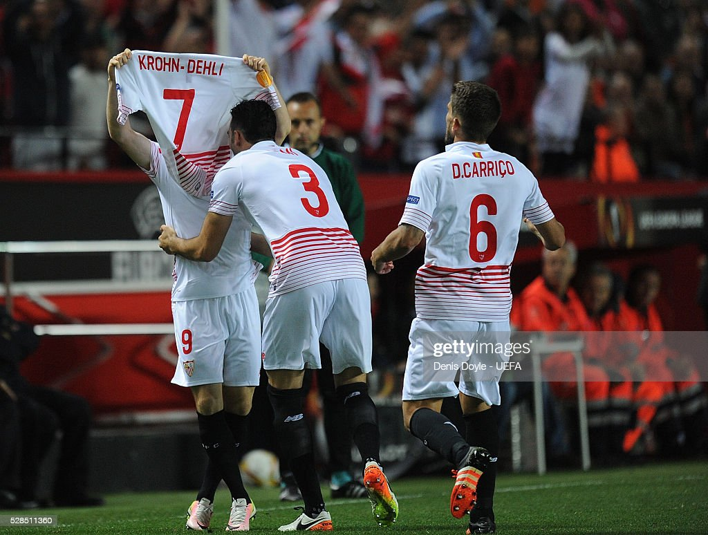 Kevin Gameiro (R) of Sevilla FC celebrates with Adil Rami after scoring his team's 2nd goal during the UEFA Europa League Semi Final second leg match between Sevilla and Shakhtar Donetsk at the Sanchez Pizjuan stadium on May 5, 2016 in Seville, Spain.
