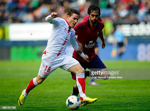 Kevin Gameiro of Sevilla FC duels for the ball with Alejandro Arribas of CA Osasuna during the La Liga match between CA Osasuna and Sevilla FC at...