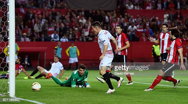 Kevin Gameiro of Sevilla scores his team's opening goal during the UEFA Europa League quarter final second leg match between Sevilla and Athletic...