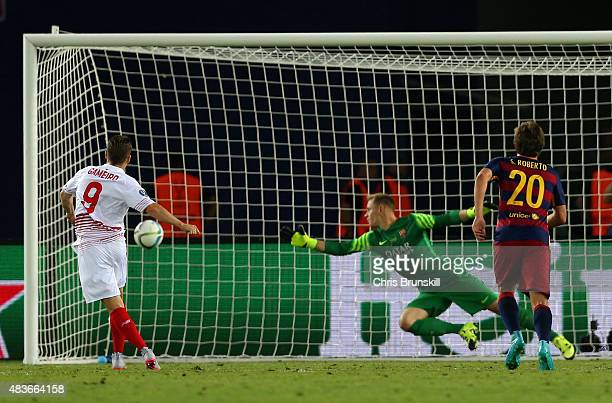 Kevin Gameiro of Sevilla scores their third goal from the penalty spot during the UEFA Super Cup between Barcelona and Sevilla FC at Dinamo Arena on...
