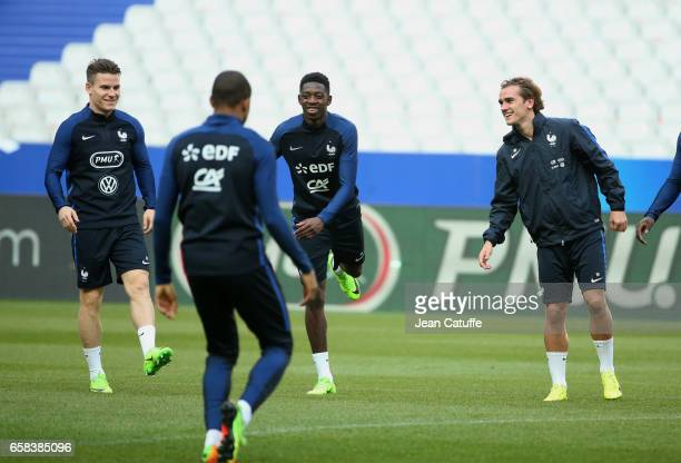 Kevin Gameiro Ousmane Dembele Antoine Griezmann of France during the training session on the eve of the international friendly match between France...