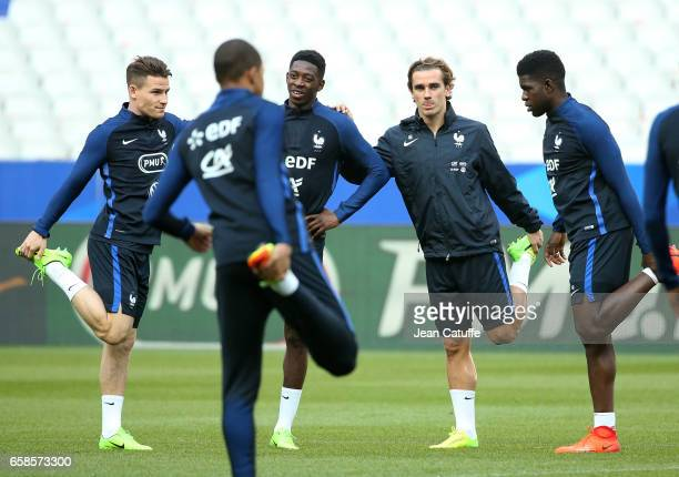 Kevin Gameiro Ousmane Dembele Antoine Griezmann Samuel Umtiti of France during the training session on the eve of the international friendly match...