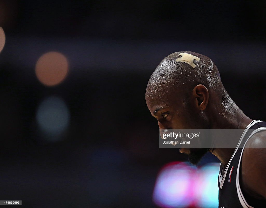 Kevin Garentt #2 of the Brooklyn Nets sports a bandage on his head during a game against the Chicago Bulls at the United Center on February 13, 2014 in Chicago, Illinois. The Bulls defeated the Nets 92-76.
