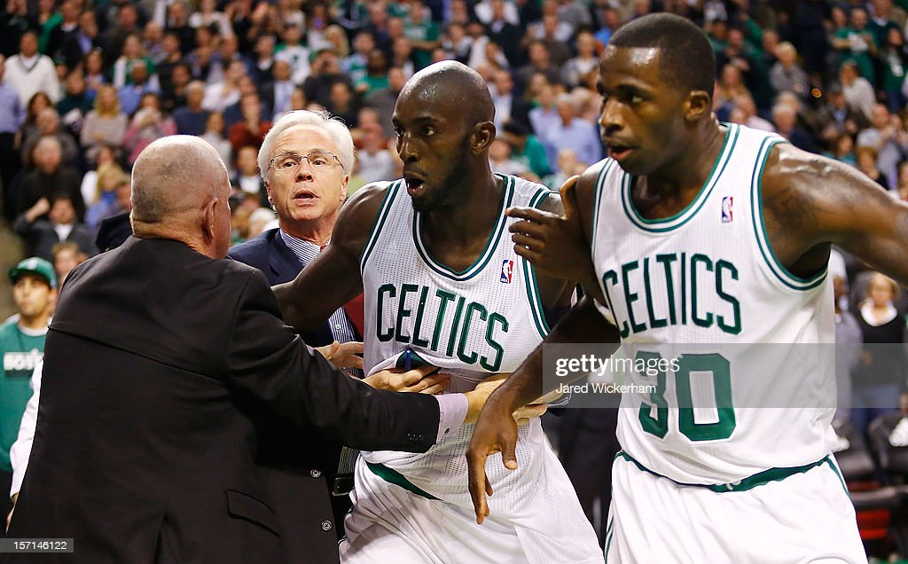 Kevin Garnett #5 and Brandon Bass #30 of the Boston Celtics are held back by coaches during a fight with members of the Brooklyn Nets during the game on November 28, 2012 at TD Garden in Boston, Massachusetts.