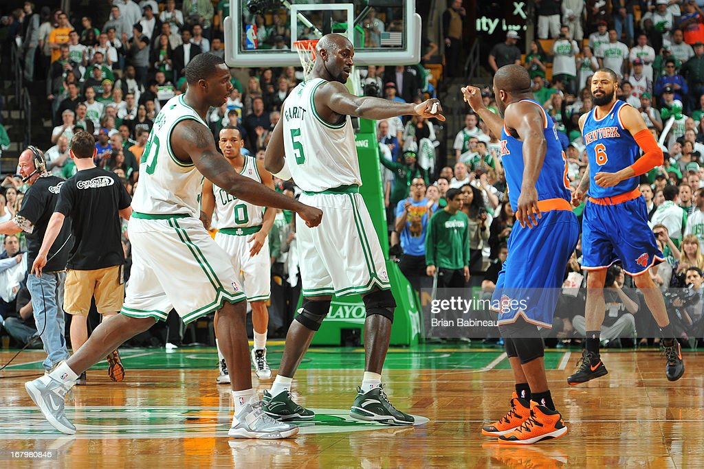 Kevin Garnett #5 and Brandon Bass #30 of the Boston Celtics greet Raymond Felton #2 of the New York Knicks before Game Six of the Eastern Conference Quarterfinals during the NBA Playoffs on May 3, 2013 at the TD Garden in Boston, Massachusetts.