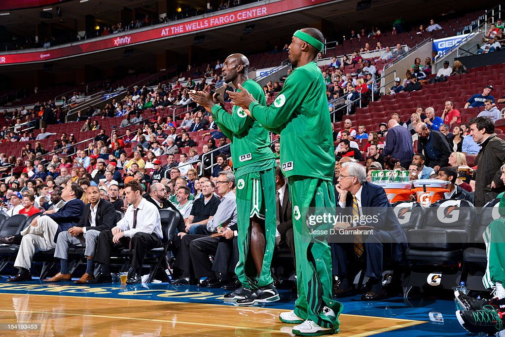 Kevin Garnett #5 and Jason Terry #4 of the Boston Celtics cheer on their teammates against the Philadelphia 76ers during a pre-season game at the Wells Fargo Center on October 15, 2012 in Philadelphia, Pennsylvania.