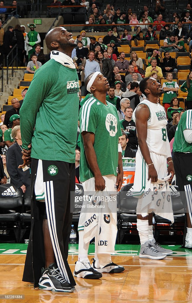 Kevin Garnett #5 and Jason Terry #4 of the Boston Celtics watching the big screen against the Portland Trail Blazers on November 30, 2012 at the TD Garden in Boston, Massachusetts.