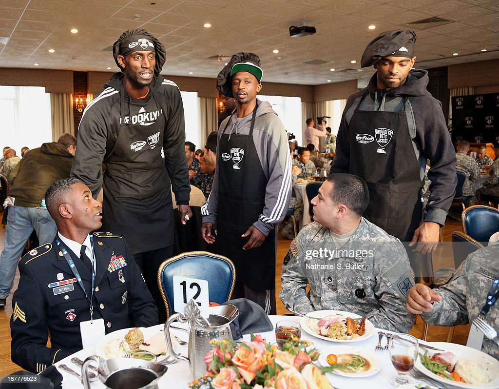 Kevin Garnett #2 and Jason Terry #31 of the Brooklyn Nets serve food during a team event in celebration of Veterans Day at Ft. Hamilton, Brooklyn on November 11, 2013 in the Brooklyn borough of New York City.