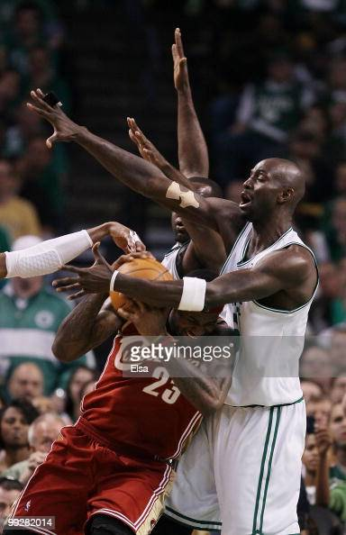 Kevin Garnett and Kendrick Perkins of the Boston Celtics keep LeBron James of the Cleveland Cavaliers from the basket in the first half during Game...
