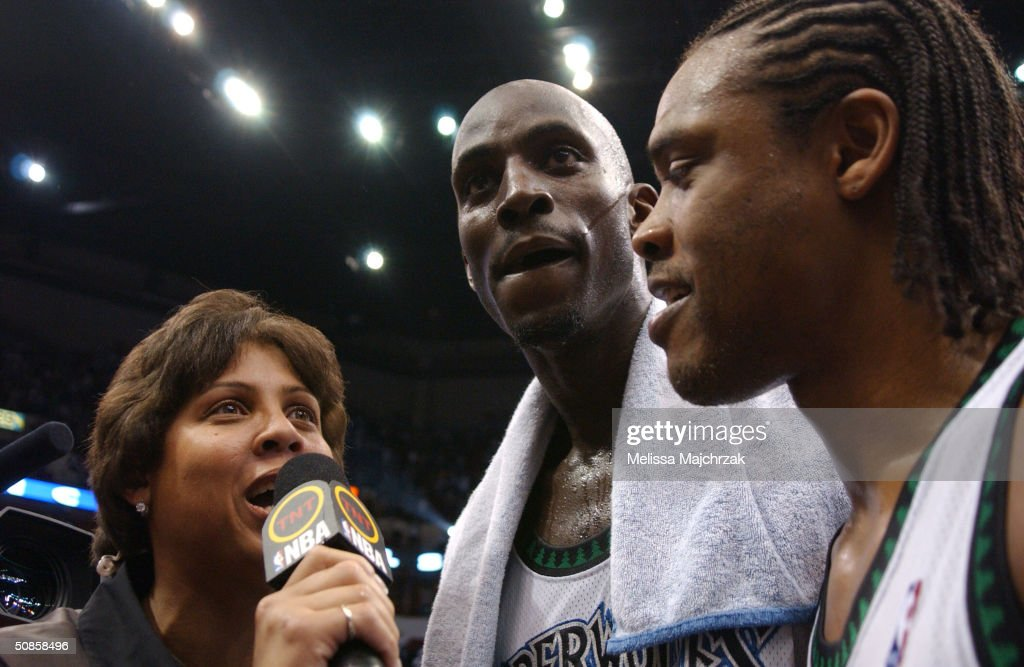 Kevin Garnett #21 and Latrell Sprewell #8 of the Minnesota Timberwolves give a post game interview with Cheryl Miller of TNT after the winning game seven against the Sacramento Kings in Game Seven of the Western Conference Semifinals during the 2004 NBA Playoffs at Target Center on May 19, 2004 in Minneapolis, Minnesota.