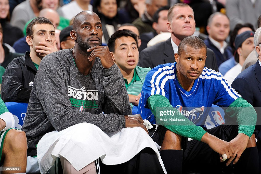 Kevin Garnett #5 and Leandro Barbosa #12 of the Boston Celtics look on from the bench during a game against the New York Knicks on January 24, 2013 at the TD Garden in Boston, Massachusetts.