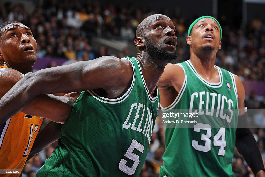 Kevin Garnett #5 and Paul Pierce #34 of the Boston Celtics battle for rebound position against Metta World Peace #15 of the Los Angeles Lakers during a game at Staples Center on February 20, 2013 in Los Angeles, California.